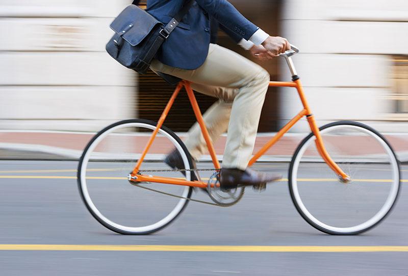 man riding orange bicycle