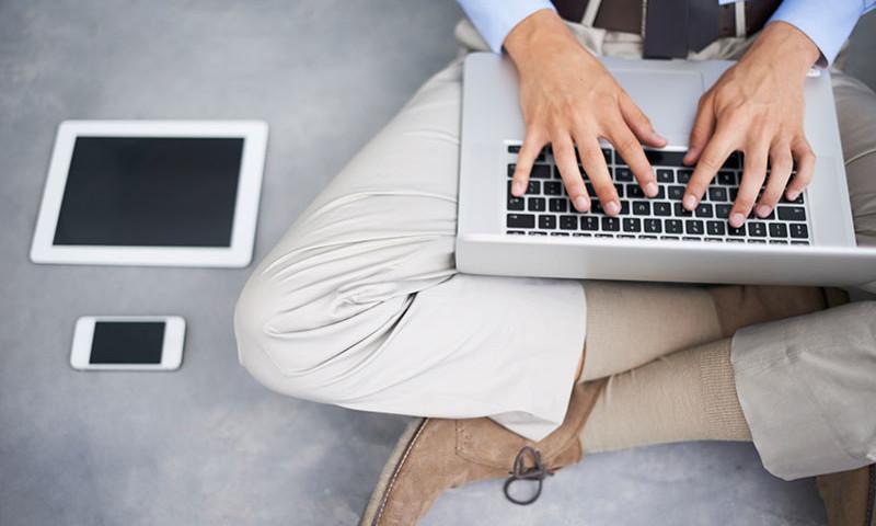 man sitting down typing